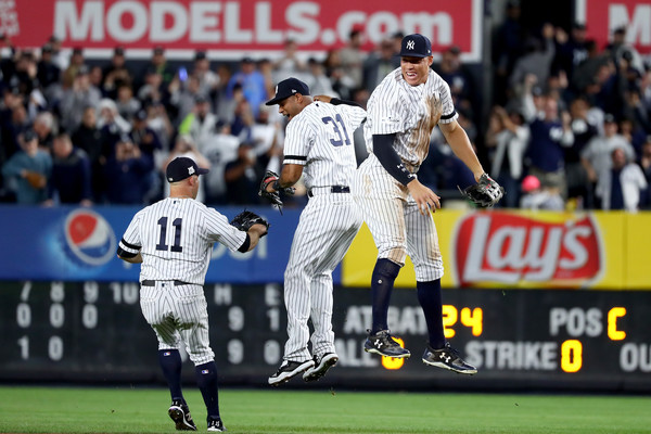 Emotion From Team, Crowd Propels New York Yankees to theALDS